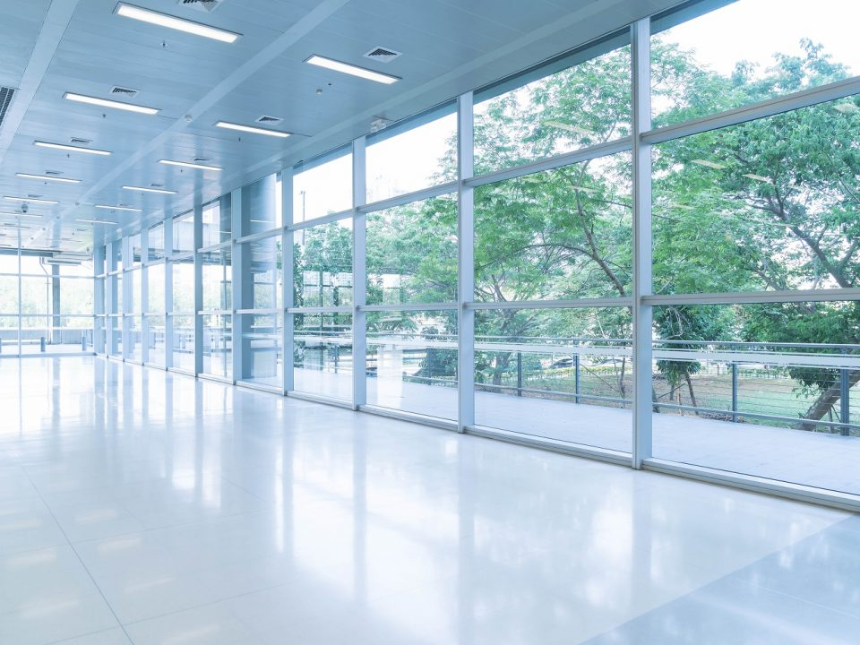 kancelarijskog prostora - blurred abstract background interior view looking out toward empty office lobby entrance doors glass curtain wall with frame 960x720 - How To Find Good Office Space in Belgrade? (SIZE)