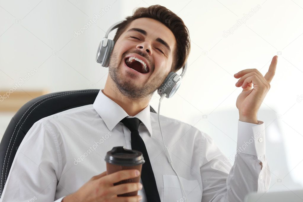 work environment - depositphotos 127218414 stock photo handsome man singing and listening1 - What's The Best Work Environment for Your Personality? [Quiz]